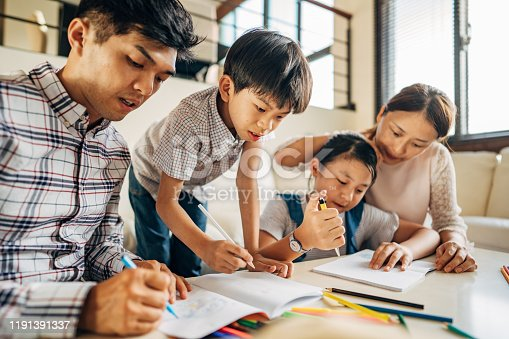 858130938 istock photo Parents doing homework with children at home 1191391337