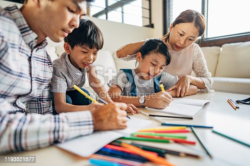 858130938 istock photo Parents doing homework with kids at home 1193521577