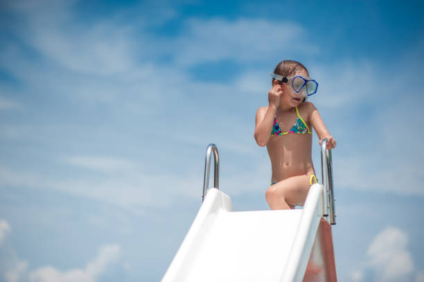 parents enjoying with children on pedalo boat - girl alone in swimsuit stock photos and pictures