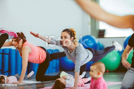 istock Parents Exercising with Their Babies in a Gym 511592978