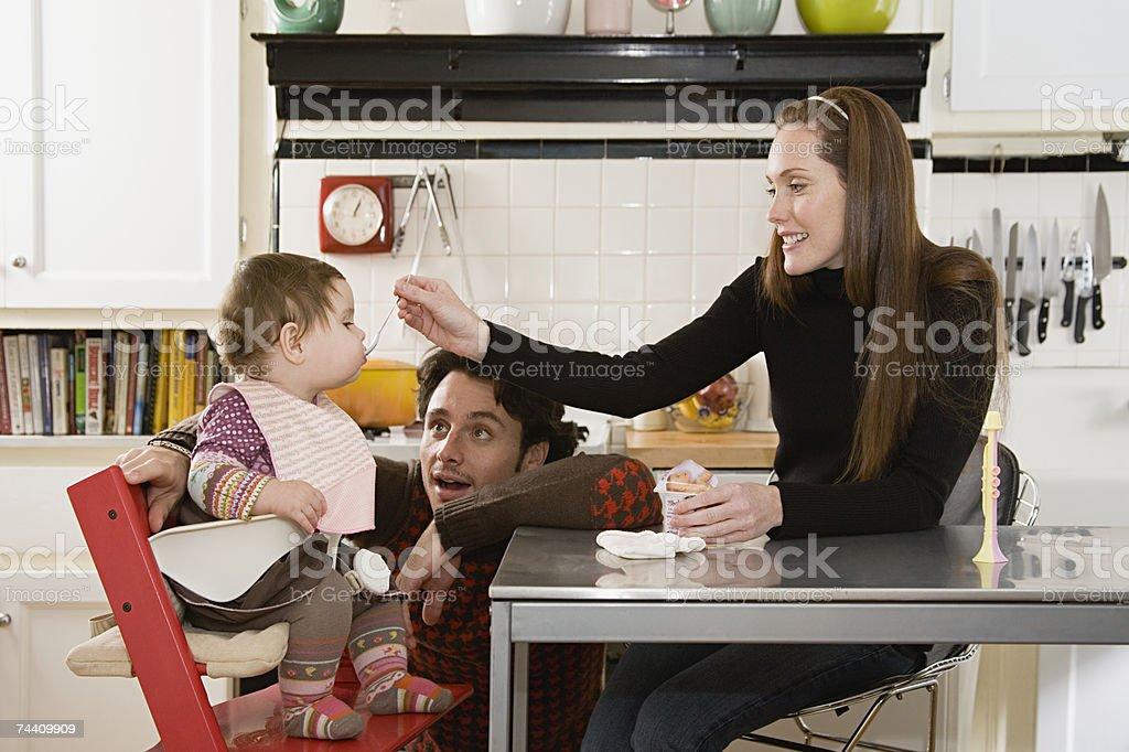 Parents feeding baby royalty-free stock photo