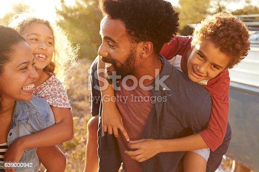 istock Parents giving their kids piggybacks, waist up, close up 639000942