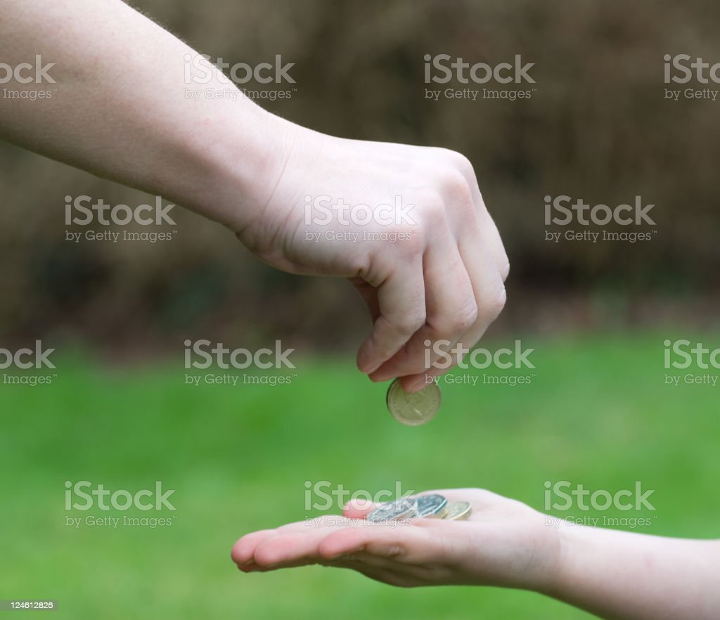 Parents hand giving Pocket money to child stock photo