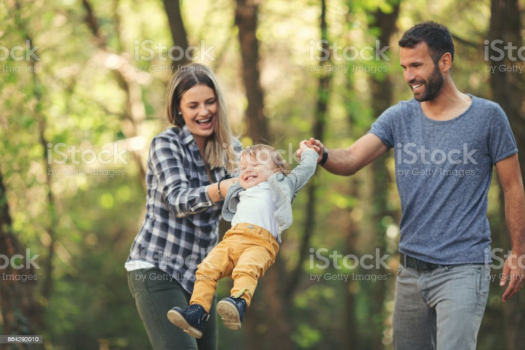 Parents having a good time with their baby boy royalty-free stock photo