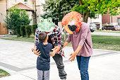 Parents having fun on Halloween with kids