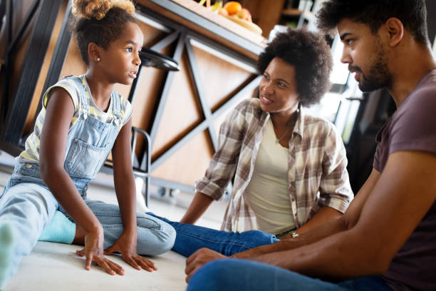 Parents having serious conversation with teenage child with problem solving attitude stock photo