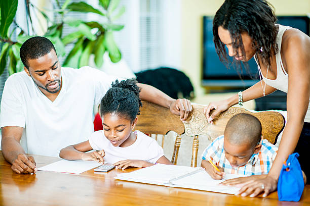 father helps son math homework pictures images and stock parents helping homework stock photo