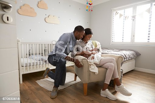 istock Parents Home from Hospital With Newborn Baby In Nursery 670930618