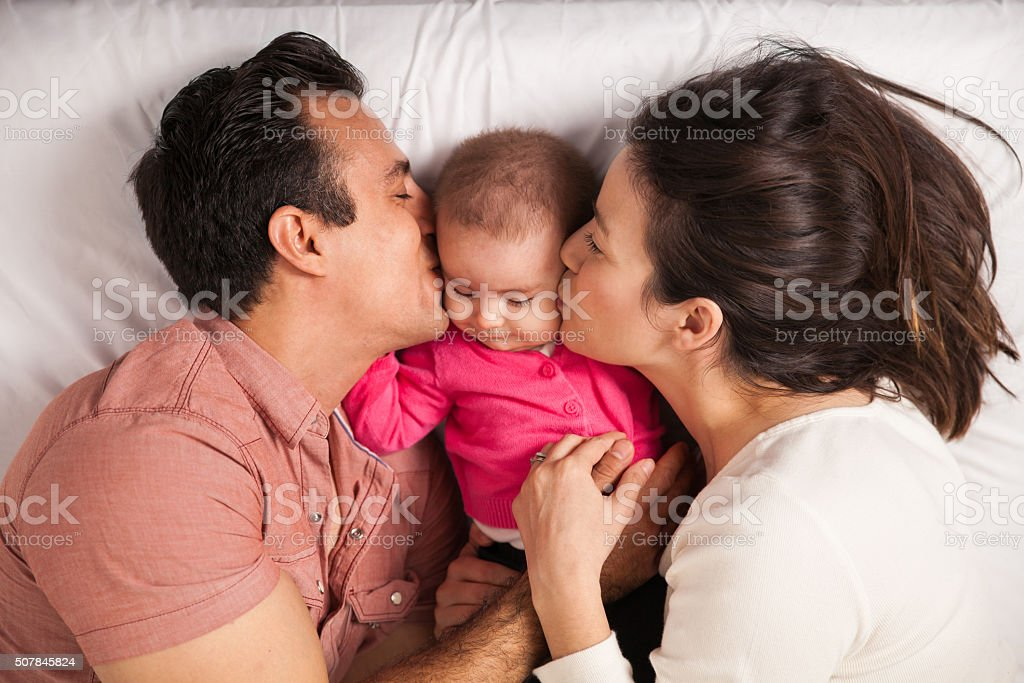 Parents in love with their baby girl stock photo