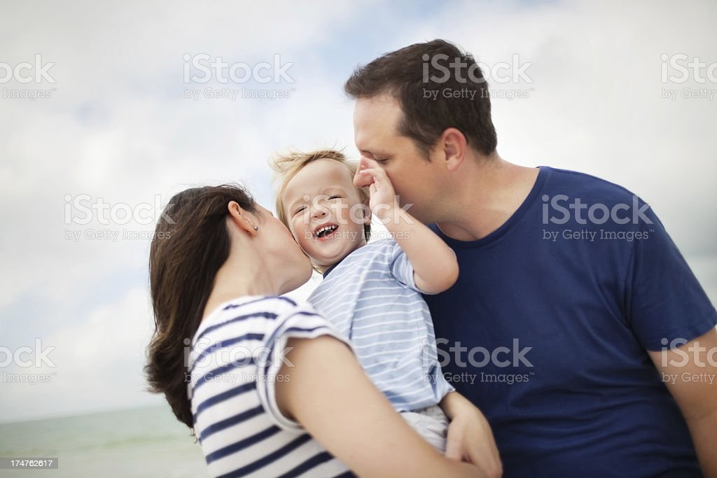 Parents Kissing Cute Little Boy royalty-free stock photo