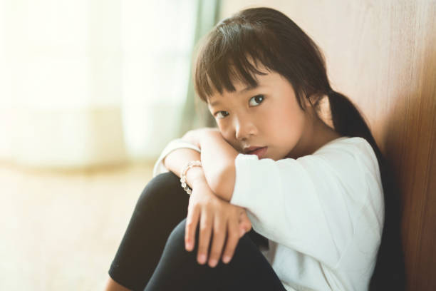 Parents left the girl To stay home alone she is very poor stock photo