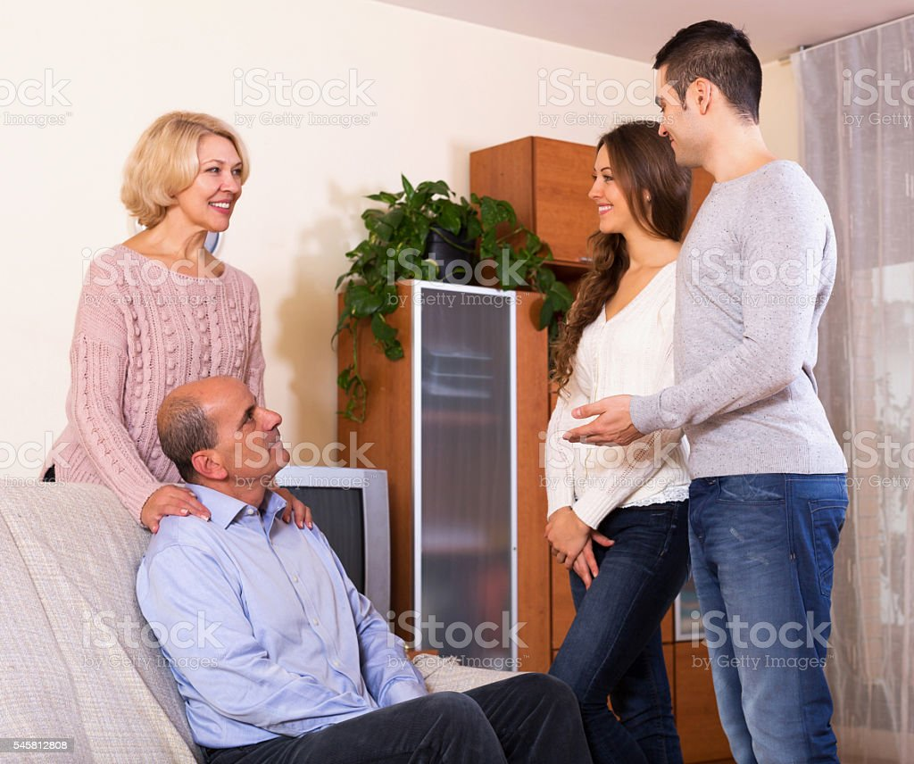 parents meeting girlfriend of their son at home today stock photo