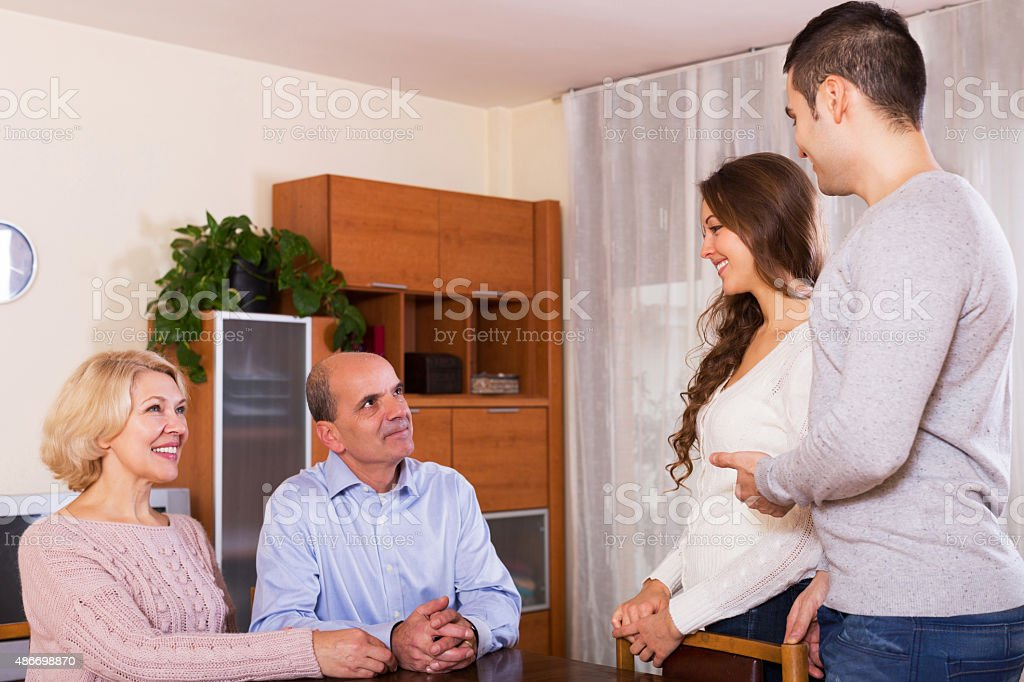 parents meeting girlfriend of their son at home yestoday stock photo