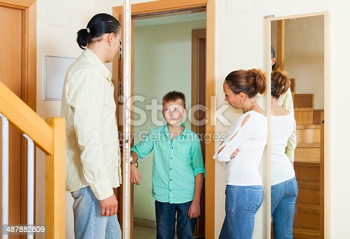 istock Parents meeting with scold of teenage son 487882809