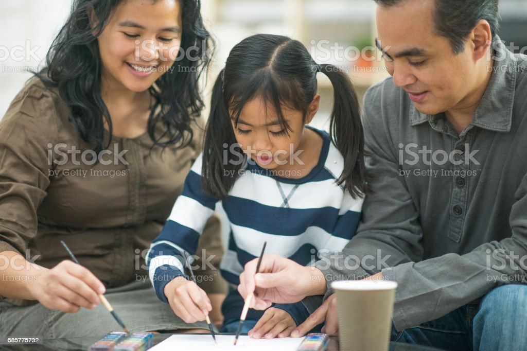 Parents Painting with their Daughter royalty-free stock photo