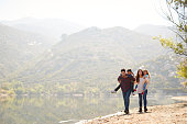 istock Parents piggybacking their young children by a mountain lake 1030966134