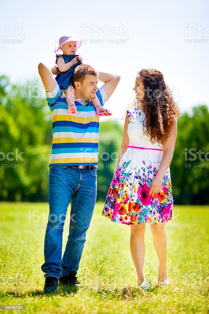 Parents Playing With Baby Outdoors. royalty-free stock photo