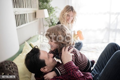 istock Parents playing with their son at home 921923678