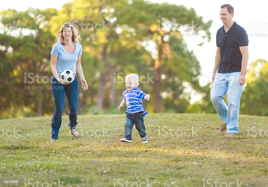 Parents playing with their son stock photo