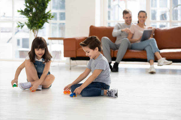Parents relaxing using device on sofa kids play on floor picture id1177916034?b=1&k=6&m=1177916034&s=612x612&w=0&h=ftxzryrgh4kqdei3bj vnowh n79pc2wsicnbjaelso=