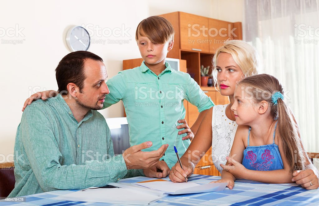Parents talk about serious financial problems stock photo