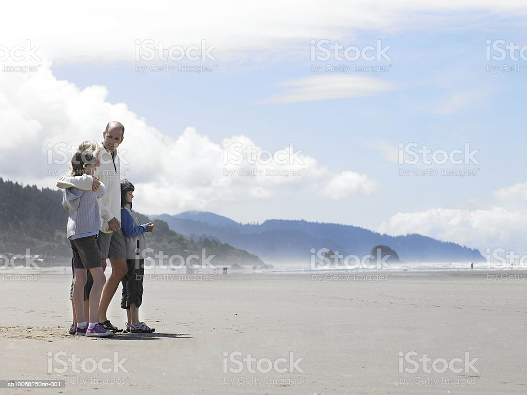 Parents with children (8-13) on beach royalty-free stock photo