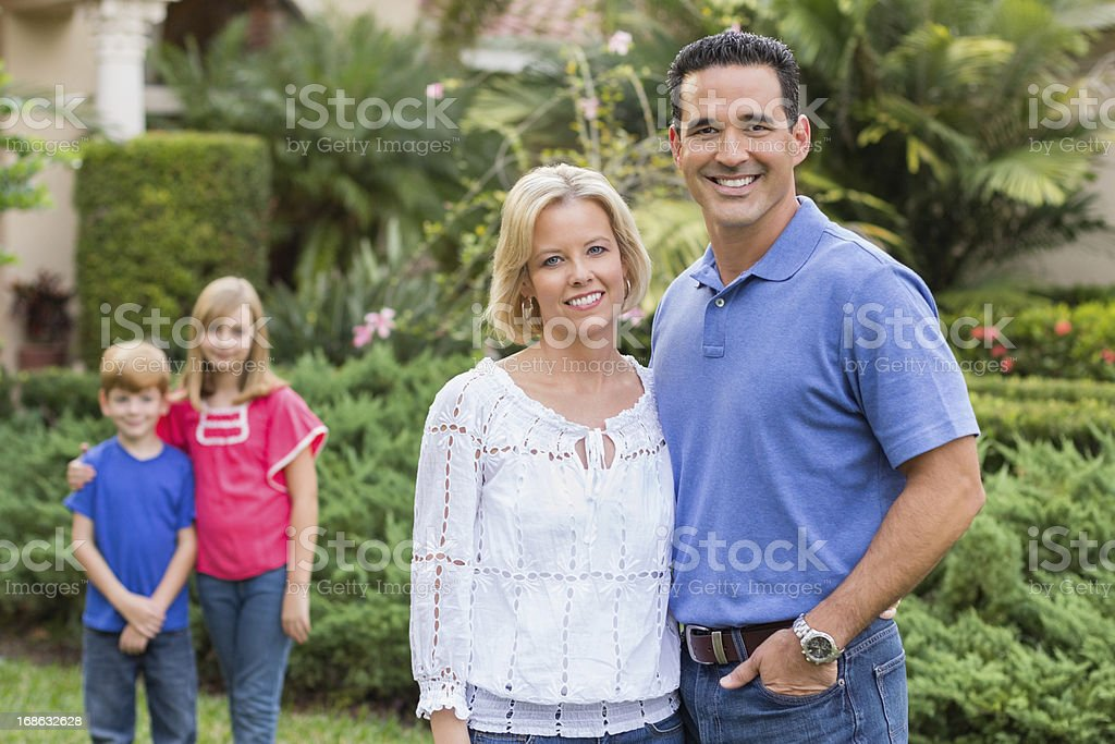Parents With Children Standing In Background royalty-free stock photo