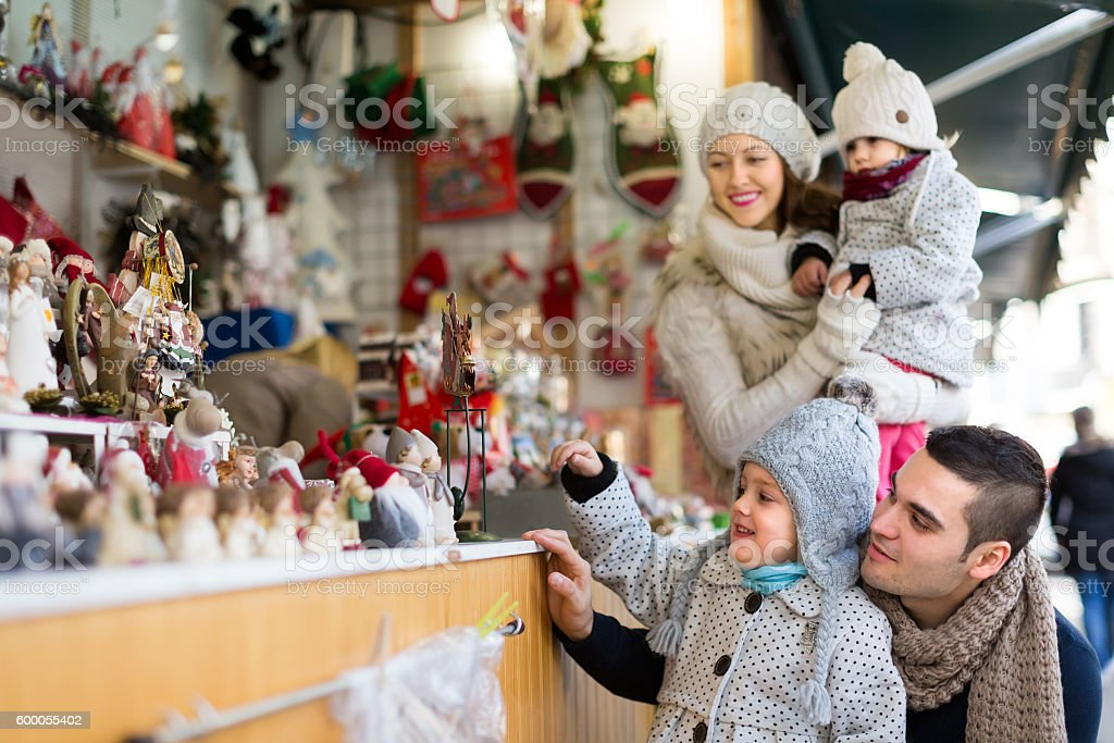 parents with kids at X-mas market stock photo