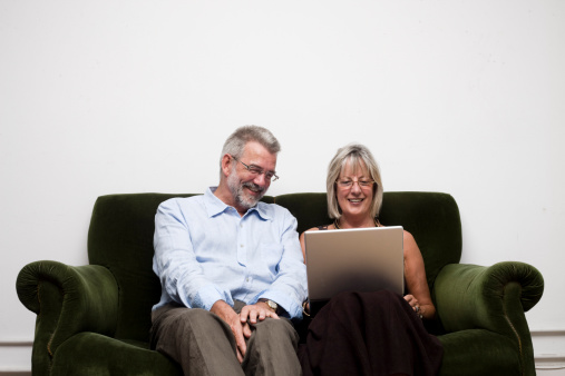 Parents With Laptop Stock Photo - Download Image Now