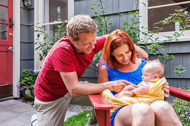 Parents with New Baby Girl at Home stock photo