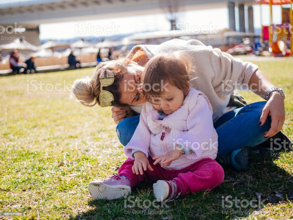 Parents with one year old baby in nature stock photo