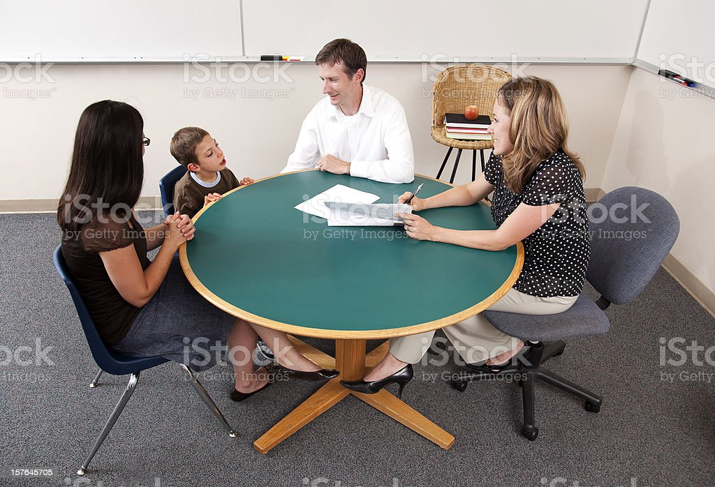 Parent-Teacher Conference from High Angle royalty-free stock photo