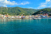 Panoramic view of the landscape from a boat. Colorful houses with clear turquoise sea.
