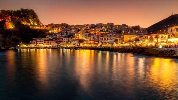 Parga town night panoramic view. Popular tourist destination of Greece. stock photo