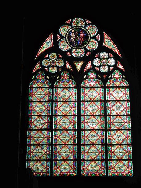 Parigi – Vetrata di Notre-dame Paris, France - January 16, 2005: Stained glass in the side aisle of the Notre Dame Cathedral. lancet arch stock pictures, royalty-free photos & images