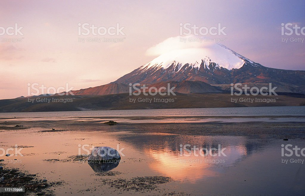 Parinacota volcano, mirrored in lake, at sunset royalty-free stock photo