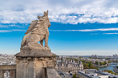 Sculptured lion which stays up the city hall of Paris, at the top of the tower Saint Jacques