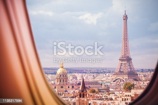 Paris and Eiffel tower panorama view from plane window illuminator during flight