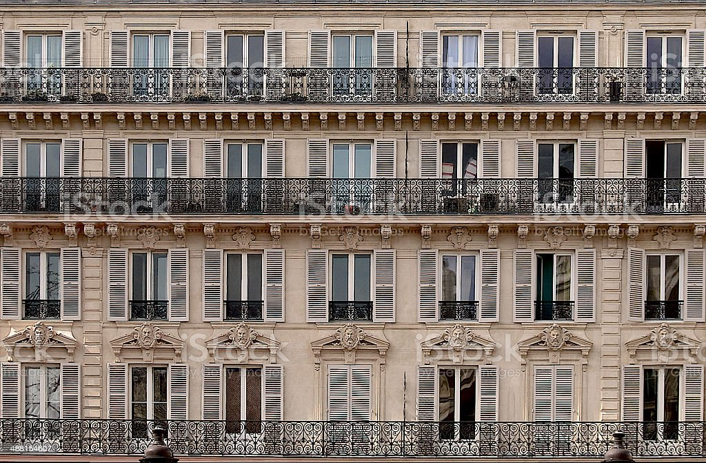 Paris apartment building facade and balconies, French architecture royalty-free stock photo