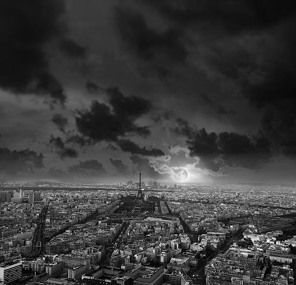 Paris at night. Moon rise with dramatic cloudscape stock photo