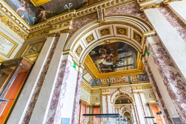 Paris attractions editorial Interior of the Louvre museum in Paris. Statues and paintings. Paris, France - July 27 2018. musee du louvre stock pictures, royalty-free photos & images
