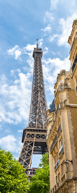 Paris, beautiful Haussmann facades in a luxury area of the capital, with the Eiffel Tower in background