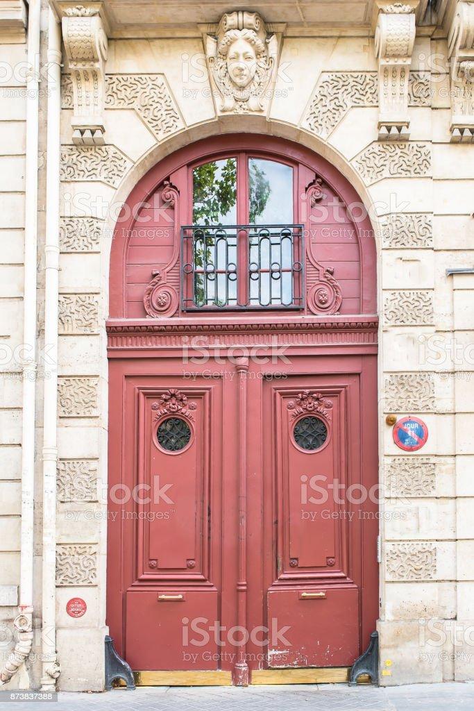 Paris, beautiful wooden red door stock photo