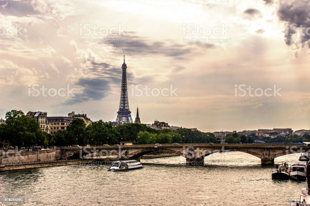 Paris City skyline with Eiffel Tower under cloudy sky in Paris, France stock photo