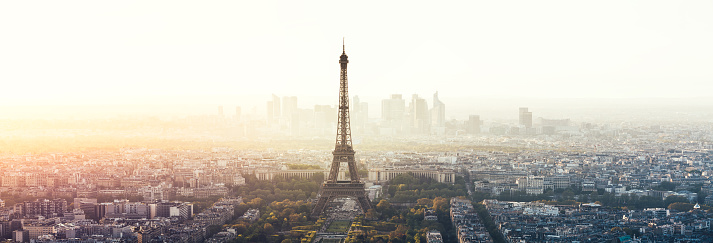 Paris cityscape panorama with Eiffel Tower at sunset (Paris, France).