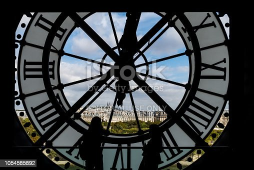 istock Paris cityscape through the giant glass clock at the Musee d'Orsay 1054585892