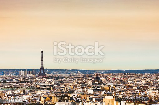 Parisian Cityscape with the Eiffel Tower and La Defence on the horizon - from a high angle showing roof tops and skyline