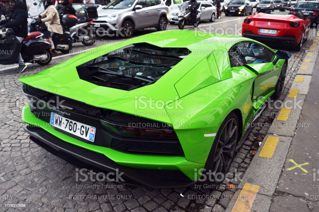 Paris France January 13th 2019 Back Of A Green Lamborghini Aventador Parked On The Champselysees You Can Also See A Red Ferrari Stock Photo Download Image Now Istock