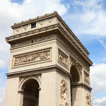 Paris, France - famous Triumphal Arch located at the end of Champs-Elysees street. UNESCO World Heritage Site.