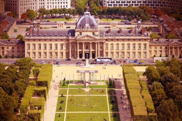 Paris, France Paris, France - aerial city view with Ecole Militaire (Military School) and Champ de Mars park. UNESCO World Heritage Site. Cross processed colors style - filtered tone retro image. ecole stock pictures, royalty-free photos & images